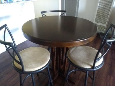 Round brown wooden dining table and 3 chairs
