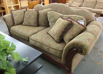 Greenish Sofa with Wood Accents
