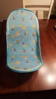 Baby bath seat collapsible for storage.
