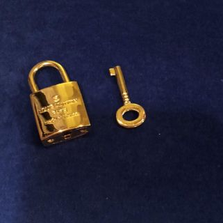 LV Louis Vuitton Gold Lock With Key. Brand New!