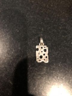 Sterling silver Swiss cheese charm