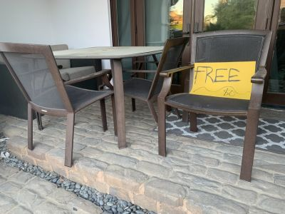 FREE. Patio table and 4 chairs.