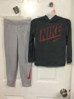 "LIKE NEW - ""NIKI"" OUTFIT / HOODED DRI FIT TOP AND PANTS WITH ELASTIC RIBBED WAIST AND CUFFS ON BOTTOM. SIZE SMALL (4-5)"
