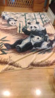 Large heavy panda bear blanket. Full size bed. Some ribbon coming off around top. See pics.