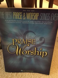 Praise and Worship Piano/Vocal/Guitar Book -almost new- $19.95 asking $5