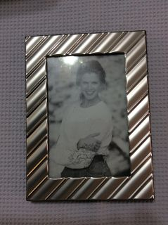 Beautiful silver colored 4 x 6 picture frame