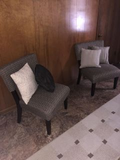Gorgeous chairs and decorative pillows