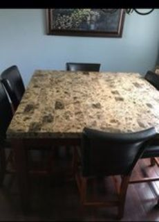 counter height dinning table and 6 chairs