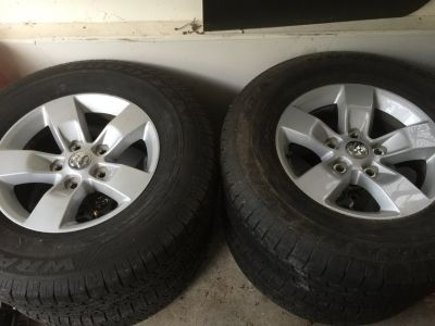 Set of 4 stock ram wheels and tires
