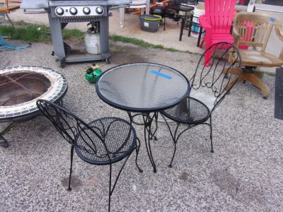 Three Piece Wrought Iron Table and Chairs Set