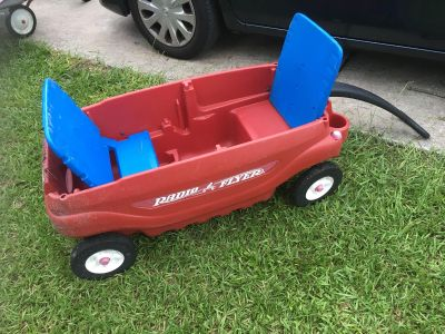 Radio Flyer red wagon with cup holders and seats (can fold down)