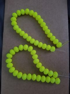 Neon yellow strands of glass beads, cross posted
