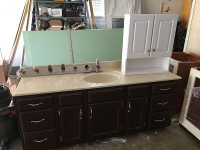 Cabinet, vanity and light