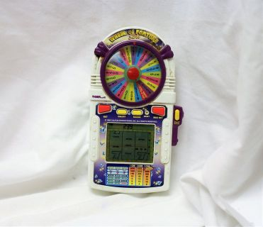 Vintage 1998 Wheel of Fortune Slot Handheld Casino Video Game Electronic Play