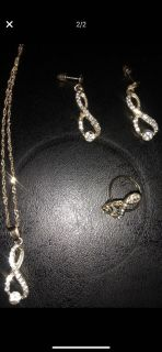 Gold, and diamond infinity necklace, earrings, and adjustable sized ring