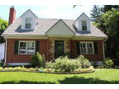Charming Four BR, 3.5 BA Brick Cape Cod! 2-Car Detached Garage w/an Offi...