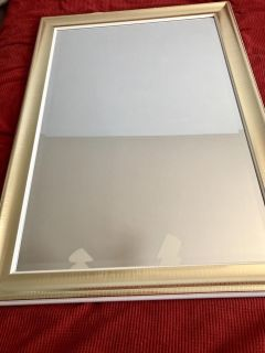 White and gold wall mirror