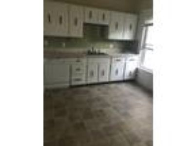 This great Four BR, One BA sunny apartment is located in the Davis Square area o
