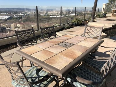 Patio table with six chairs and Sunbrella cushions. Outdoor table, metal table, Sunbrella