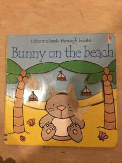 Usborne book .Bunny on beach.Bunny is bit ripped otherwise good condition.
