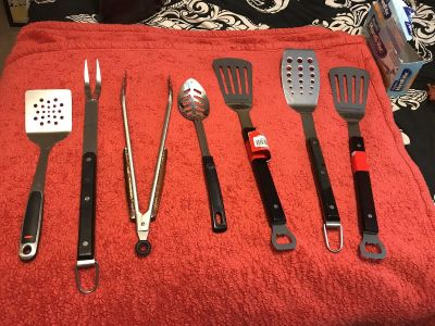 Assorted heavy duty kitchen / grilling tools.
