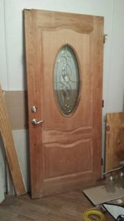 unfinished solid wood entry door with oval glass