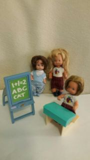 Older small dolls with a desk and a chalkboard I believe that these are vintage but not sure.