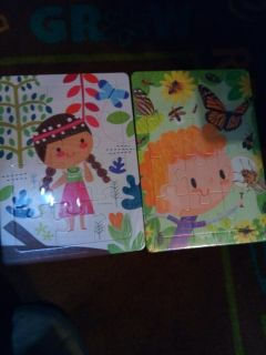 (2) NEW in package puzzles (8X10)
