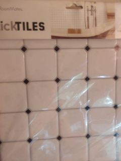 12 packages of Room Mates Stick Tiles