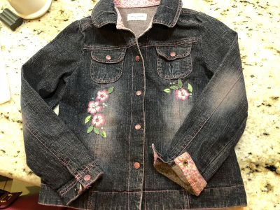 Adorable girls jean jacket barely worn. Size 8/10