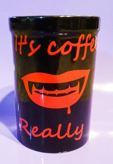 "Vampire Coffee - black ceramic mug with red words ""It's Coffee. Really"" and a set of vampire fangs - 16 ounces"