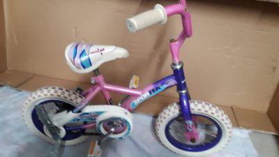 Girls bike with training wheels.