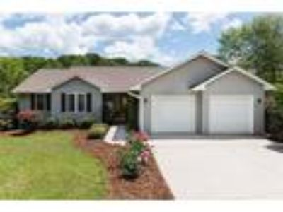 Large fenced backyard and plenty of room to g...