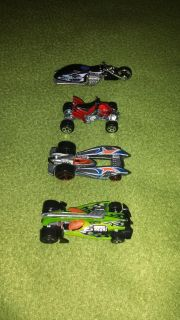 Four Hot Wheels motorcycles & race cars