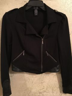 Swoosh jacket, size L on tag but I would say closer to medium unless you have smaller chest and short waist, washable,asymmetrical zip front