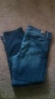 Like new American eagle jeans straight leg super stretch size 18 bottoms are cut see pic