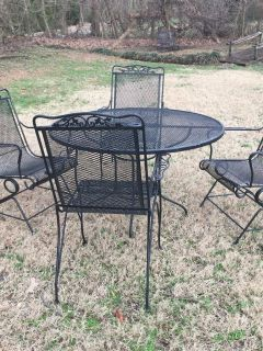 """Wrought iron table and chairs: 2 are stationary and 2 """"rock"""""""