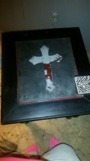 2 black end tables w/cross on them.