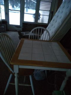 White tile table and 3 chairs