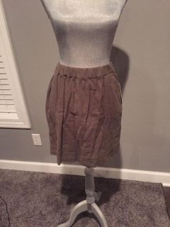 Women's olive/brown colored skirt - elastic waistband. Size 4, new with tags. retails for $32