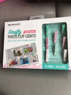 New In Box Photo Clip Lights. Holds 16 pictures, notes or artwork. White glow lights.