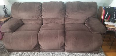 Chocolate Brown Reclining couch and loveseat