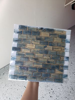 One box of ten 12 x 12 rectangle Horizon Sky 1 x 2 in. Brick Glass