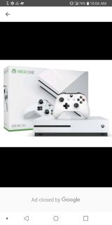 Xbox one s with 2 controllers and a charging dock