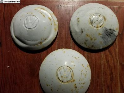 Three Commercial German Original hubcaps