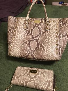 "PRICED TO SELL - Michael Kors purse and wallet 11 1/2 inches at bottom and 15 inches at top. 6 "" wide and 11"" tall. Wallet is 8x4"