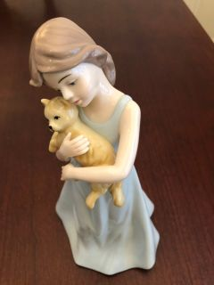 Girl with cat Lladro style statue