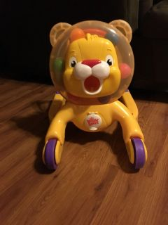 Push or ride on lion with balls