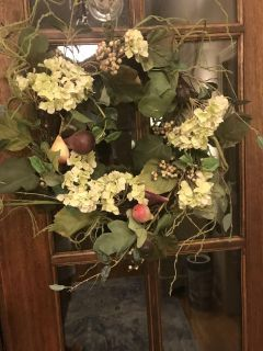 Beautiful spring wreath with artificial hydrangea flowers