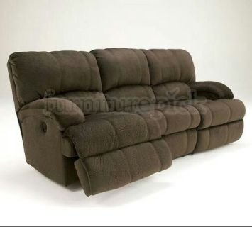 Ashleys love seat and couch with stain warranty
